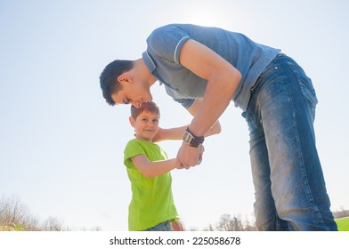 Father's care of his son outdoors