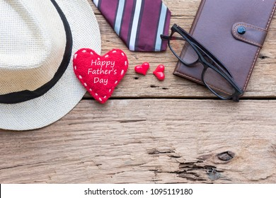 Father's Day accessories on wooden table.