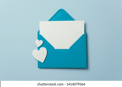 Father's Day card mockup. Blue envelope blank white card and hearts
