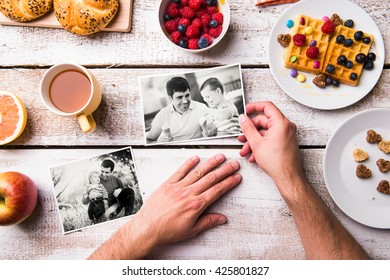Fathers day composition. Black-and-white photos, breakfast meal