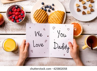 Fathers day composition. Greeting card and breakfast meal. Fathers day. Concept for fathers day celebration. Best father. Child and father concept. We love you daddy text.