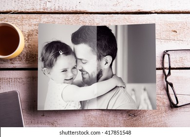 Fathers day composition. Picture of father holding his daughter