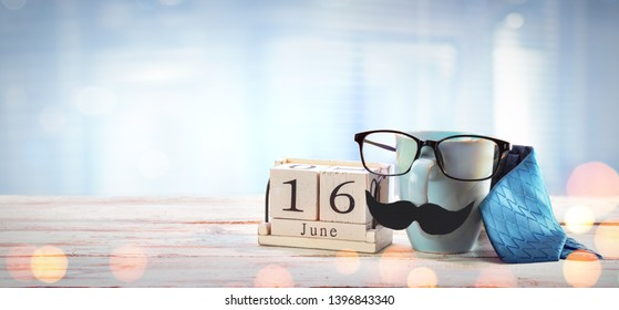 Fathers Day Concept - Mug Glasses And tie On Table