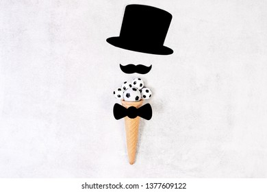 Father's day conceptual flat lay. Funny moustache and hat on ice cream cone