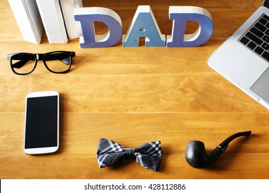 Father's Day desktop workspace with gadgets and accessories