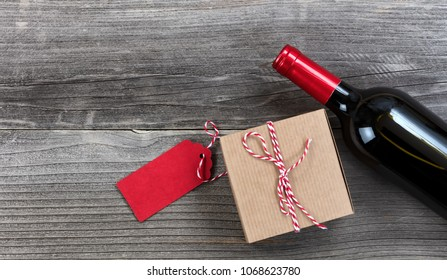 Fathers day gift box with red wine bottle on vintage wooden plank background
