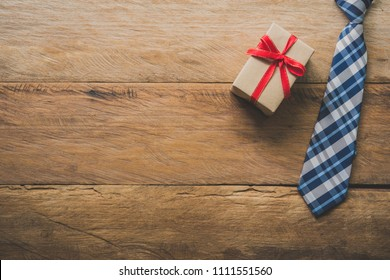 Father's Day Gift Ideas - Neckties and gift boxes are placed on wooden floor.