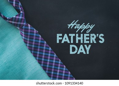 Father's Day graphic for celebration of holiday.  Includes plaid tie on black background with text.