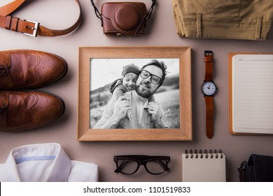 Fathers day greeting card concept. A photo of a dad and toddler son. Flat lay.