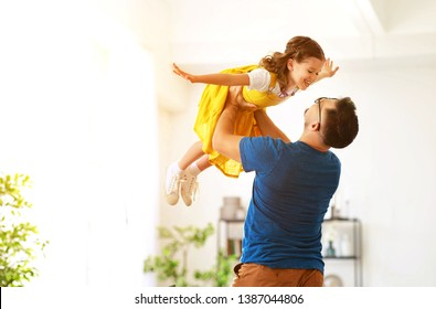 Father's day. Happy family daughter hugs his dad  on holiday