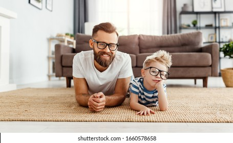 Father's day. Happy funny family son  and dad with glasses on holiday