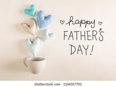 Father's Day message with blue heart cushions coming out of a coffee cup