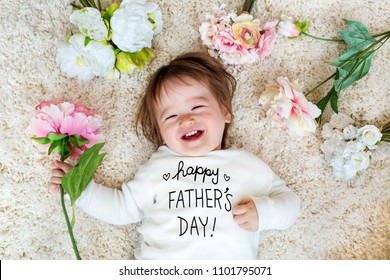 Father's Day message with happy toddler boy with spring flowers