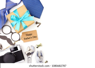 Fathers Day side border of gifts, ties and decor isolated on a white background. Top view with copy space.