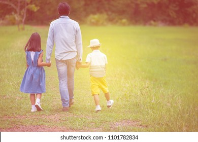 Father's hand, son and his daughter lead in wild nature, summer outdoor, family trust, family concept.