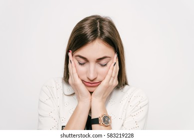 fatigue of a young girl in a photo studio. Pain, depression, fatigue.