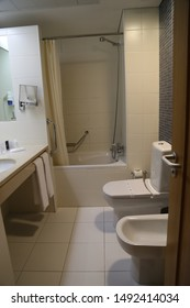 Fatima, Europe / Portugal - June 2018: Lux Fatima Park Hotel,white toilet and bidet in the bathroom with black ceramic tiles of a tourist hotel room