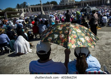 Fatima, Portugal - May 13, 2014: Crowd of people at the Sanctuary of Fatima during the celebrations of the apparition of the Virgin Mary in Fatima, Portugal.