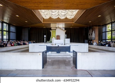 Fatima, Portugal - May 13, 2014: Pilgrims at the Chapel of the Apparitions at the Sanctuary of Fatima during the celebrations of the apparition of the Virgin Mary in Fatima, Portugal.