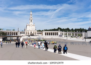 Fatima, Santarem, Portugal - June 11 2018 : Pilgrims crawling on their knees to the shrine at Fatima on the belief to get the health of their or their family members recovered.