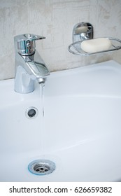 Faucet with sink in the bathroom