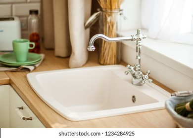 faucet with the sink in bright kitchen