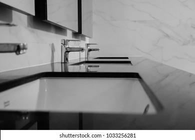 faucet with  sinks in modern bathroom white black  background