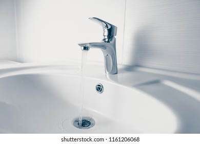 faucet and wash sink with flowing water