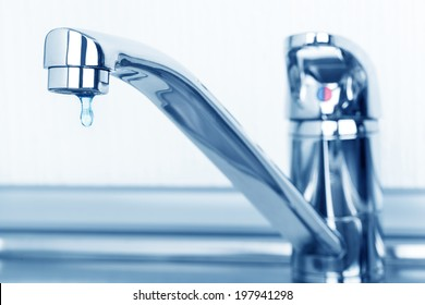 Faucet and water drop