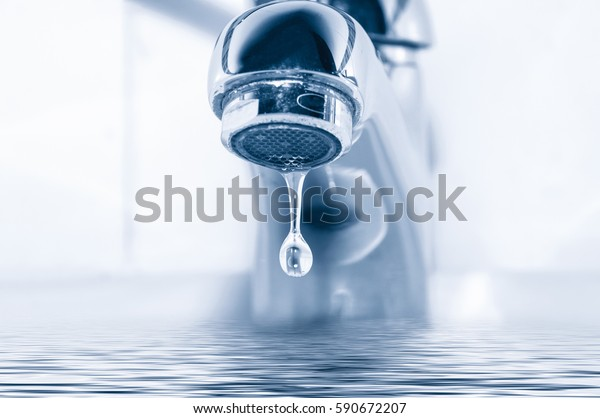 Faucet and water drop close up