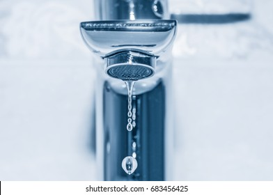 Faucet with water drops close up