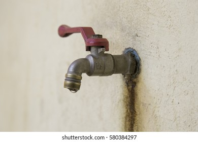 Faucet,Aluminium water tap in Wall background.