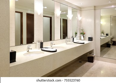 Faucets with washbasin in public restroom ,Contemporary interior of public toilet.