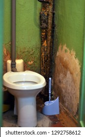 faulty toilet, sewage with shabby walls and dirt. The concept of protection, relocation and relocation