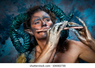 Faun.  man with a mythological creature with  antlers