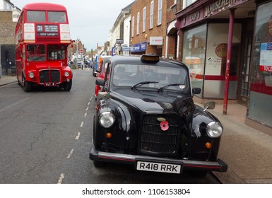 FAVERSHAM, KENT, UK - MAY 12: A classic London taxi together with a Routemaster bus at the annual classic vehicle show, May 12, 2018, at Faversham, UK.