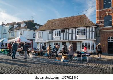 Faversham, Kent, UK, November 2019 - Ancient timber framed building and market stalls in the medieval town of Faversham, Kent, UK