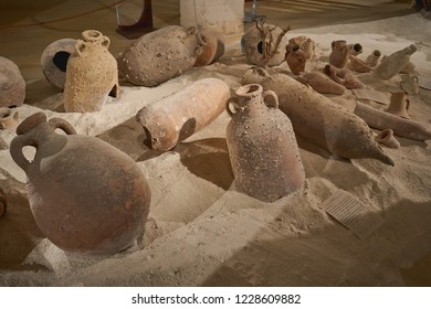 Favignana, Italy - November, 2018. Group of ancient terracotta vases (or amphorae) found in the Mediterranean Sea from a shipwreck, displayed in the local Museum.