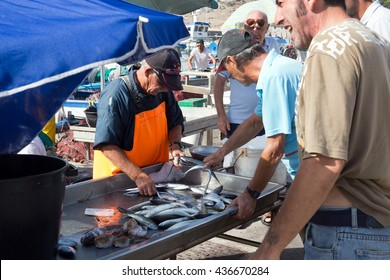 FAVIGNANA - SEPTEMBER 16: Fisherman sells fresh fishes directly in the harbor on September 16, 2015 in Favignana, Italy.The island is famous for the fishing of tuna fish in Aegadian Islands, Southern
