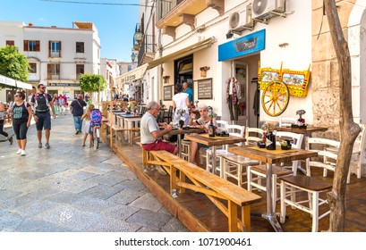 Favignana, Trapani, Italy - September 22, 2016: Visitors relax and enjoy the coastline at the restaurant in the center of Favignana island, is the largest of the three Aegadian islands.