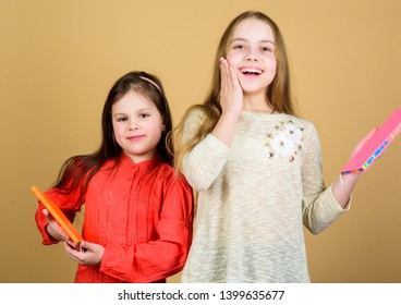 Favorite fairytale. Sisters pick books to read together. Adorable girls love books. Secret diary or personal journal. Smart is great. Kids girls with books or notepads. Education and kids literature.