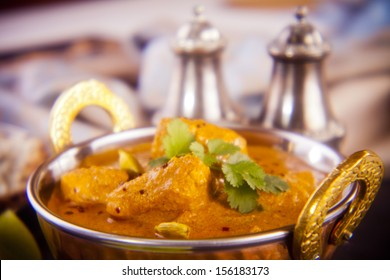 Favourite Indian meal, butter chicken with basmati rice, naan bread and lime. Holga lens, deliberately soft definition.