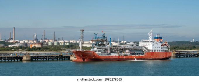 Fawley, Hampshire, England, UK. 2021.  The Happy Penguin a LPG tanker ship alongside at Fawley refinery on Southampton Water, England, UK