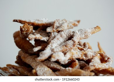 Faworki (angel wings), sprinkled with powdered sugar.Traditional, Polish carnival delicacy. Crisp cake with a sweet taste, in the shape of a complex bow, fried in deep fat and sprinkled with powdered