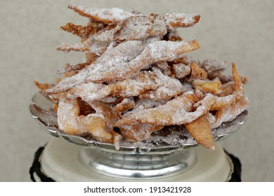 Faworki (angel wings), sprinkled with powdered sugar, brushwood, kerchief, chrissy, crepe.Traditional, Polish carnival delicacy. Crisp cake with a sweet taste, in the shape of a complex bow.