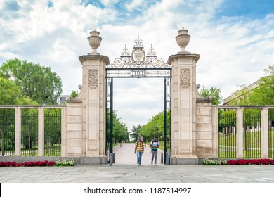 FAYETTEVILLE, AR/USA - JUNE 8, 2018: Unidentified inviduals and campus gates to the University of Arkansas.