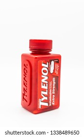 Fayetteville , North Carolina/ USA - March 07 2019 : A container of Tylenol caplets pain reliever and fever reducer on white background.
