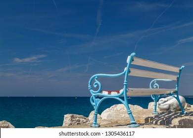 FAZANA / CROATIA - AUGUST 2015: Bench on the pier in Fazana town in Istria, Croatia