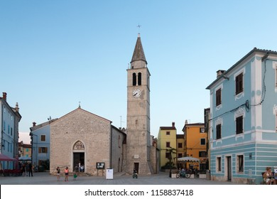 Fazana, Croatia - July 28, 2018: View of the market square with church of Fazana in the evening sun, Croatia.