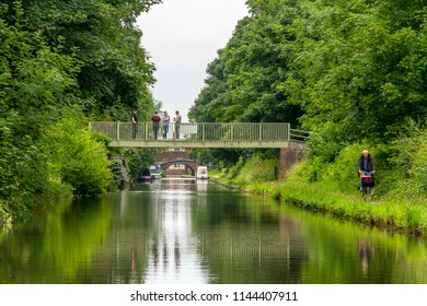 FAZELEY, STAFFORDSHIRE, UK - JUNE 27, 2017: A waterside view, as seen from a narrowboat cruising along the scenic Birmingham and Fazeley Canal, in the heart of rural England.
